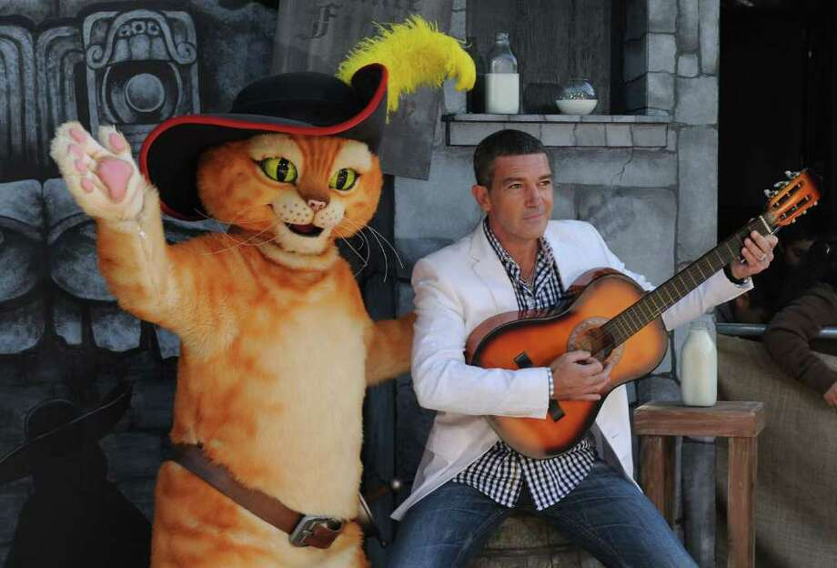 """Antonio Banderas arrives at the premiere of """"Puss In Boots,"""" Sunday, Oct. 22, 2011, at The Regency Village Theater in Los Angeles. """"Puss In Boots"""" opens in theaters on Oct. 28, 2011. Photo: AP"""