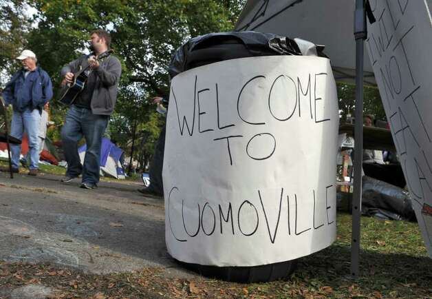 A sign next to a garbage can names the Occupy Albany encampment for Governor Andrew Cuomo, in Academy Park on Monday Oct. 24, 2011 in Albany, NY. (Philip Kamrass / Times Union ) Photo: Philip Kamrass / 00015102A