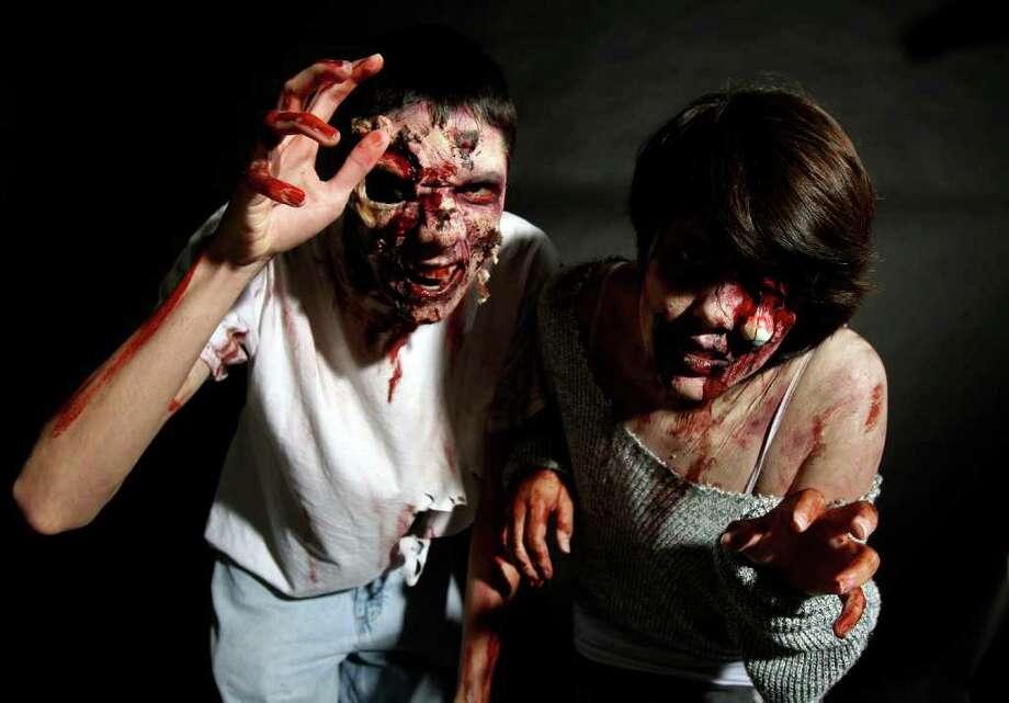 CONEXION: Anthony Gonzales and Susan Maxwell as Zombies for Conexion halloween cover. Photo: HELEN L. MONTOYA, San Antonio Express-News / SAN ANTONIO EXPRESS-NEWS