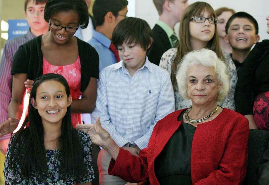 FOR METRO - Wallace B. Jefferson Middle School seventh grader Sophia Carranco, 12, (left) and other students pose for photos with retired United States Supreme Court Associate Justice Sandra Day O'Connor at the school Monday Oct. 24, 2011 after an iCivics presentation by the students. iCivics is a free online program designed to teach students civics and inspire participation in the democratic process.  (PHOTO BY EDWARD A. ORNELAS/eaornelas@express-news.net) Photo: EDWARD A. ORNELAS, SAN ANTONIO EXPRESS-NEWS / © SAN ANTONIO EXPRESS-NEWS (NFS)