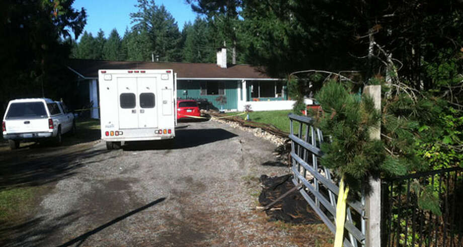 An ambulance sits outside the Thurston County home Monday.
