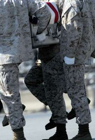 A Marine carry team moves a transfer case containing the remains of Lance Cpl. Benjamin W. Schmidt Saturday, Oct. 8, 2011 at Dover Air Force Base, Del. According to the Department of Defense, Schmidt, 24, of San Antonio, died Oct. 6, 2011 while conducting combat operations in Helmand, province, Afghanistan. Photo: AP