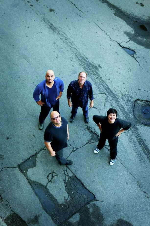 The Pixies -- Joey Santiago, David Lovering, Kim Deal and Black Francis. clockwise from top left -- will bring their Doolittle tour to the Palace in Waterbury Saturday night, Oct. 29. Photo: Contributed Photo