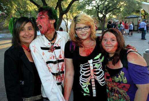 From the left, Lily Gaona, Robert Cervantez, Ceara McCoy and Desiree Strange at the 2011 Zombie Walk, Sunday, October 23, 2011 at Hemisfair Park in San Antonio. Photo: J. MICHAEL SHORT, SPECIAL TO THE EXPRESS-NEWS / THE SAN ANTONIO EXPRESS-NEWS