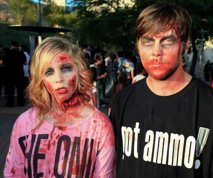 From the left, Caitlin Thompson and Clayton Davis at the 2011 Zombie Walk, Sunday, October 23, 2011 at Hemisfair Park in San Antonio. Photo: J. MICHAEL SHORT, SPECIAL TO THE EXPRESS-NEWS / THE SAN ANTONIO EXPRESS-NEWS