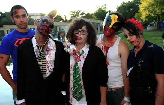 From the left, Steve Watts, Curtis Adams, Brenda Taylor, Adam Hippler and Iriana Vega at the 2011 Zombie Walk, Sunday, October 23, 2011 at Hemisfair Park in San Antonio. Photo: J. MICHAEL SHORT, SPECIAL TO THE EXPRESS-NEWS / THE SAN ANTONIO EXPRESS-NEWS