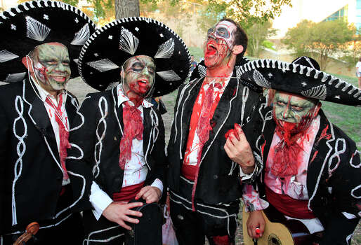 From the left, Jeff Moore, Chris Stokes, Marcus Elliott and James Mendoza at the 2011 Zombie Walk, Sunday, October 23, 2011 at Hemisfair Park in San Antonio. Photo: J. MICHAEL SHORT, SPECIAL TO THE EXPRESS-NEWS / THE SAN ANTONIO EXPRESS-NEWS