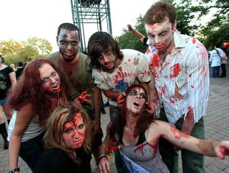 From the left in back, Libby Austin, Brad West, Mitchell Poe, Rob Schonhoff, and in front, Lauren Salguero and Melissa Poe at the 2011 Zombie Walk, Sunday, October 23, 2011 at Hemisfair Park in San Antonio. Photo: J. MICHAEL SHORT, SPECIAL TO THE EXPRESS-NEWS / THE SAN ANTONIO EXPRESS-NEWS