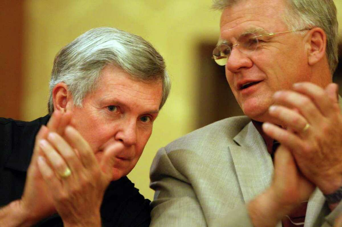 Texas coach Mack Brown (left) and A&M's Mike Sherman are unlikely to face each other again after Thanksgiving.