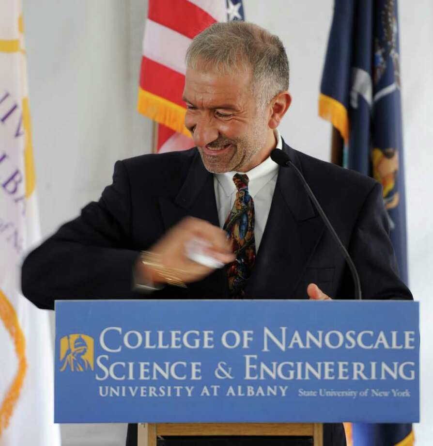 College of Nanoscale Science and Engineering of the University at Albany Senior VP and CEO Dr. Alain Kaloyeros throws the script away as he announces the launch of CNSE's Solar Energy Development Center in Halfmoon, N.Y.  October 24, 2011. (Skip Dickstein/Times Union) Photo: Skip Dickstein / 000151094A