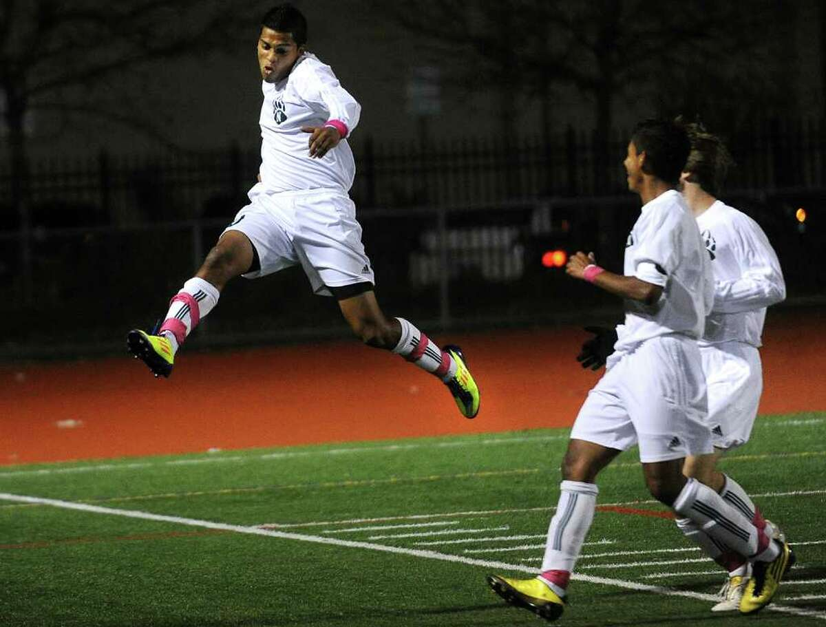 Norwalk's Nic Zuniga leaps in the air in celebration after scoring the first of his three first half goals in the Bears' matchup with New Canaan at Norwalk High School on Monday, October 24, 2011.