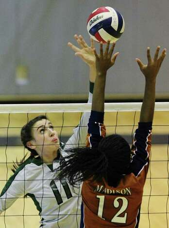 Reagan's Ashlie Reasor (11) had 41 kills, a .367 hitting percentage and five blocks as the Rattlers rallied to defeat top-ranked Johnson in five games and Madison in three. She averaged five kills per game for the week. Photo: Kin Man Hui/kmhui@express-news.net / San Antonio Express-News