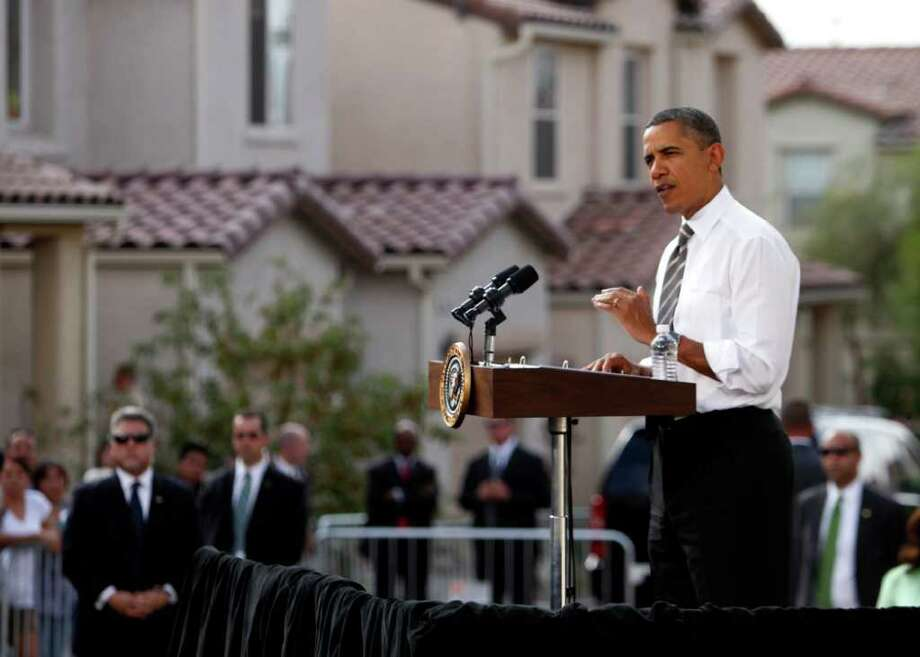 President Barack Obama speaks in Las Vegas, Monday, Oct. 24, 2011. Obama, in Las Vegas during a three-day trip to the West Coast, announced new rules to help homeowners with little or no equity in their home to refinance their mortgages to avoid foreclosures. (AP Photo/John Locher) Photo: JOHN LOCHER