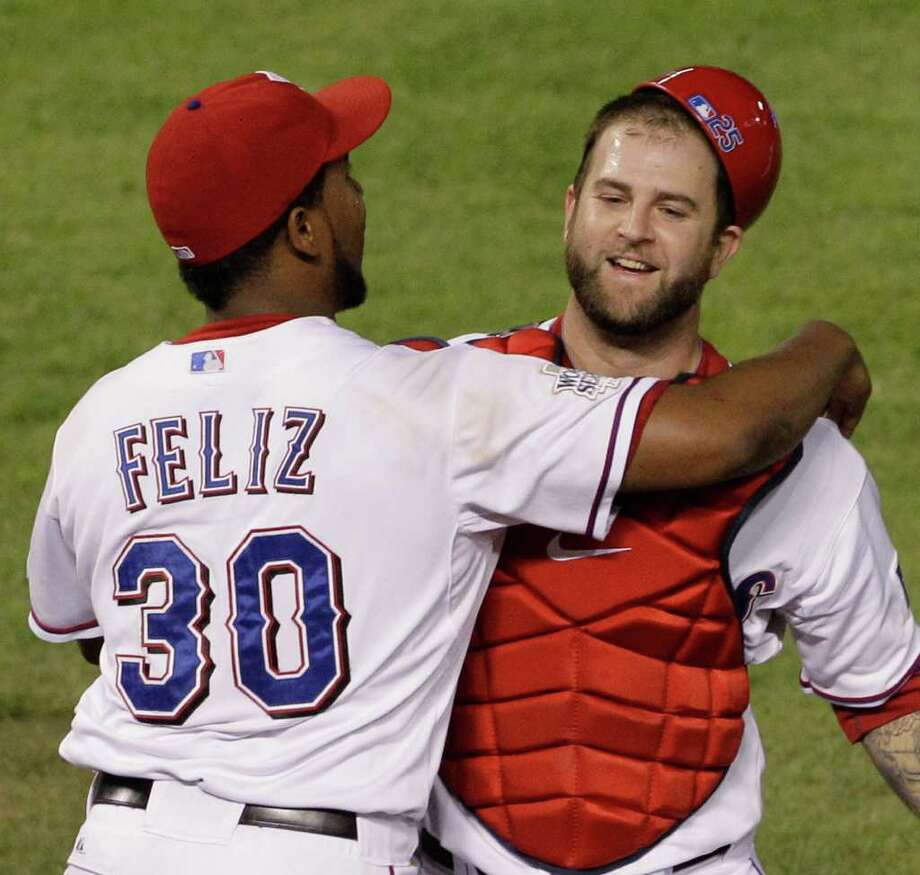 Texas Rangers' Neftali Feliz and Mike Napoli celebrate after Game 5 of baseball's World Series against the St. Louis Cardinals Monday, Oct. 24, 2011, in Arlington, Texas. The Rangers won 4-2 to take a 3-2 lead in the series. (AP Photo/Paul Sancya) Photo: Paul Sancya, Associated Press / AP