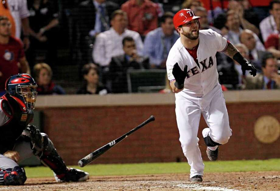 Texas Rangers catcher Mike Napoli hits a two-run double in the eighth inning. The Texas Rangers defeated the St. Louis Cardinals, 4-2, during Game 5 of the World Series at Rangers Ballpark in Arlington, Texas, on Monday, October 24, 2011. (Vernon Bryant/Dallas Morning News/MCT) Photo: Vernon Bryant, McClatchy-Tribune News Service / Dallas Morning News