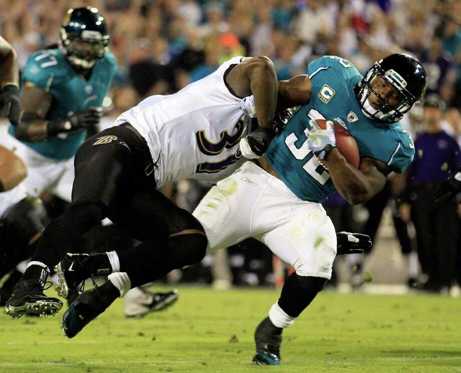 Oct. 24: Jaguars 12, Ravens 7. Maurice Jones-Drew #32 of the Jacksonville Jaguars is tackled by  Bernard Pollard #31 of the Baltimore Ravens during the game at EverBank Field on October 24, 2011 in Jacksonville, Florida. Photo: Sam Greenwood, Getty / 2011 Getty Images