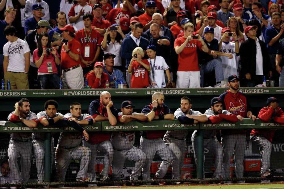Cardinals look on in the ninth inning. Photo: Rob Carr / 2011 Getty Images