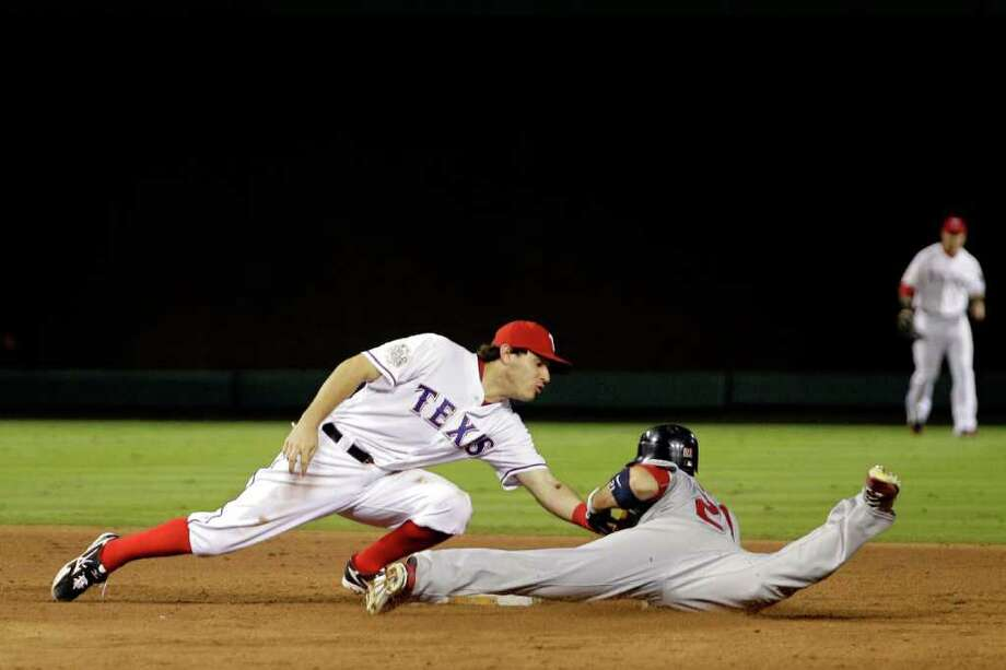 Allen Craig of the St. Louis Cardinals is caught stealing at second base by Ian Kinsler of the Texas Rangers. Photo: Rob Carr / 2011 Getty Images