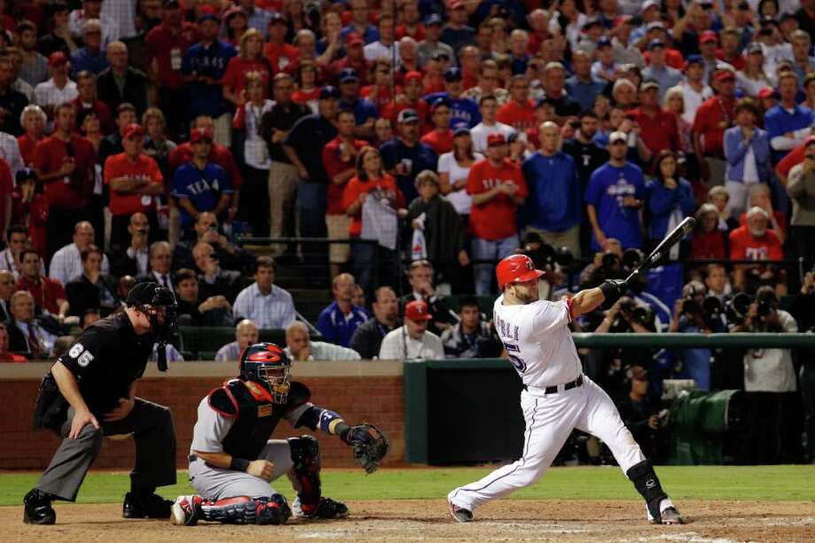Mike Napoli of the Texas Rangers hits a two-run double in the eighth inning. Photo: Rob Carr / 2011 Getty Images