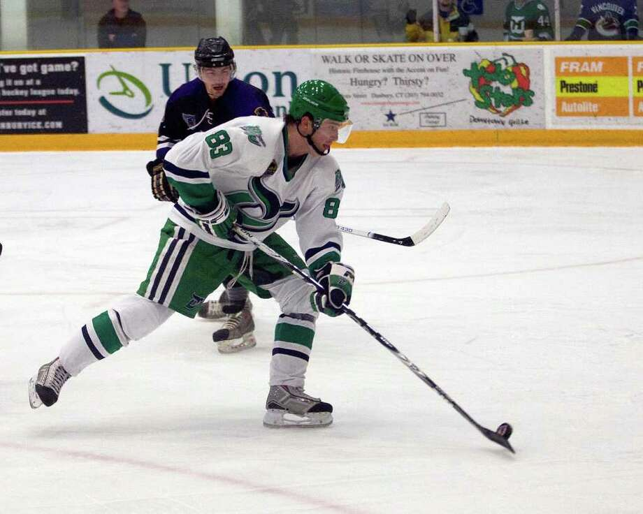 The Whalers' Chris Seifert scores a goal against the Cape Cod Barons Friday night at the Danbury Arena. Photo: Barry Horn