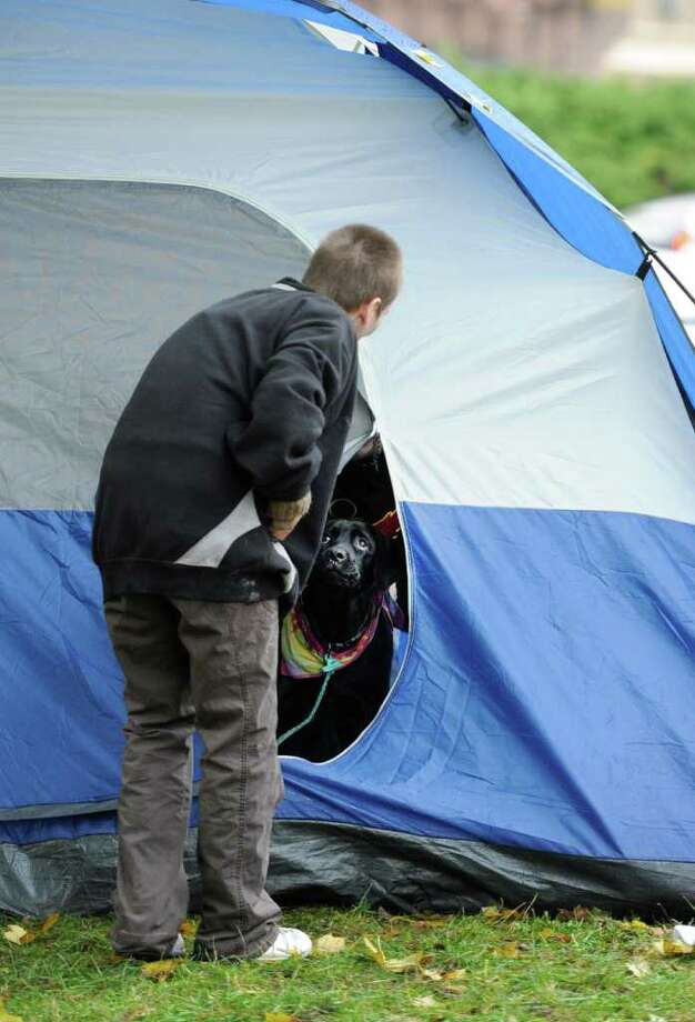 Ann Larose checks tent tenant as the morning starts  at the Occupy Albany tent city in Academy Park in Albany on Tuesday, Oct. 25, 2011. (Skip Dickstein/Times Union) Photo: Skip Dickstein / NWest PRS 2011