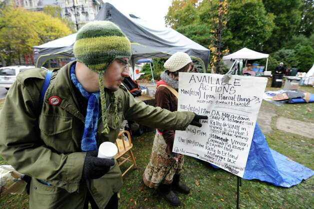 Reuben Bruchez checks the schedule of activities at the Occupy Albany tent city in Academy Park in Albany, N.Y. October 25, 2011. (Skip Dickstein/Times Union) Photo: Skip Dickstein