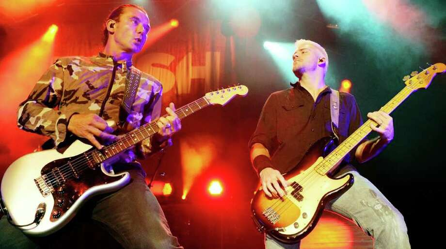 "Bush singer/guitarist Gavin Rossdale (left) and bassist Corey Britz perform at The Joint inside the Hard Rock Hotel & Casino in Las Vegas in support of the new album, ""The Sea of Memories."" GETTY IMAGES Photo: Ethan Miller, Getty Images / 2011 Getty Images"