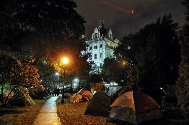 View of tents in Academy Park across from the Capitol during the Occupy Albany encampment there just after 9 pm on Monday night Oct. 24, 2011 in Albany, NY. (Philip Kamrass / Times Union ) Photo: Philip Kamrass / 00015102A