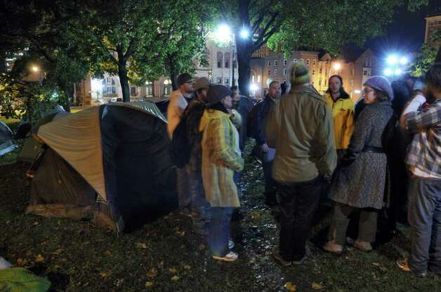 A group from the Occupy Albany encampment gathers to discuss security and how to use non violent means to settle problems  in Academy Park across from the Capitol at 9:30 pm on Monday night Oct. 24, 2011 in Albany, NY. (Philip Kamrass / Times Union ) Photo: Philip Kamrass / 00015102A