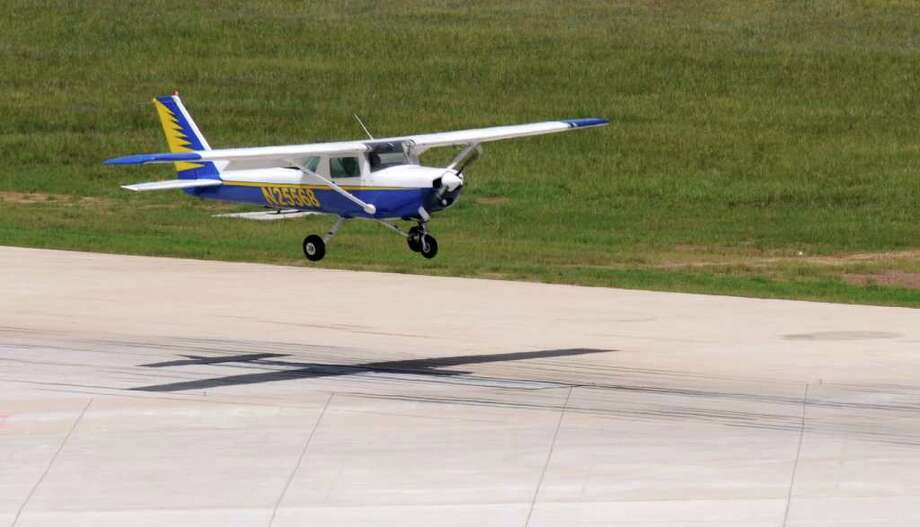 A new report reveals the U.S. Drug Enforcement Administration flies small surveillance aircraft, like this Cessna, over American cities. At least 30 are registered in Houston.  Photo: Jerry Baker / Freelance