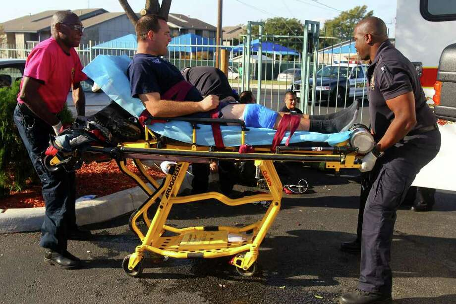 San Antonio EMS paramedics prepare to transport a San Antonio firefighter that injured an ankle at the scene of a fire that broke out Tuesday October 25, 2011 at the Fiesta Inn and Suites on the 4900 block of Northwest Loop 410 near Summit Parkway. About nine units at the extended stay hotel were affected by the fire which was electrical in nature and started in a kitchen of a bottom floor apartment. The injured firefighter was transported to Stone Oak Methodist Hospital.(photo by John Davenport/jdavenport@express-news.net) Photo: SAN ANTONIO EXPRESS-NEWS
