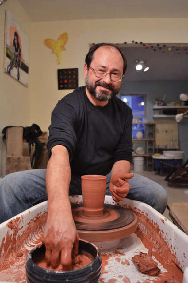 Jim Best often incorporates spiritual expressions or political statements into his intricate and beautiful sculpture. Photos by Tyler Murphy/Life@Home. Read the story here and watch a video of Best working the potter's wheel here.