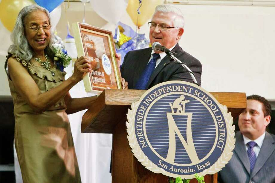 "Neff Middle School principal Sylvia Wade (left) receives a framed plaque reading ""Pat  M. Neff Middle School, 1961-2011, 50 Years of Excellence"" from NISD Superintendent Dr. John Folks as State Rep. Trey Martinez-Fischer looks on during the 50th Anniversary celebration of the school on Oct. 18. Photo: MARVIN PFEIFFER, Marvin Pfeiffer/Prime Time Newspapers / Prime Time Newspapers 2011"