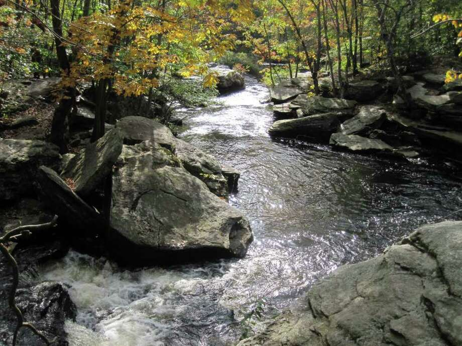 The Cascades, where the Mill River rushes past boulders, is one of the signature scenes in Fairfield's Lake Monhegan Open Space. Photo: Contributed Photo / Fairfield Citizen contributed