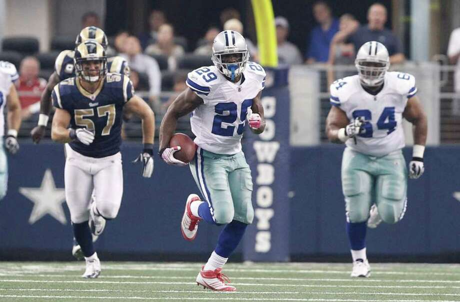 Cowboys guard Montrae Holland (right) delivered key blocks for teammate DeMarco Murray (center) during the rookie's franchise-best rushing performance Sunday against the Rams. Holland had been cut by Dallas in September. Photo: Brandon Wade, Associated Press