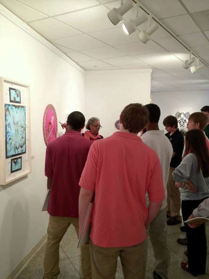Students from Notre Dame High School in Fairfield listen as Sacred Heart University gallery educator Mary Kordak explains a piece in the Contemporary Art Galleryís latest exhibit, called Fluidity, Layering, Veiling. Photo: Contributed Photo / Connecticut Post Contributed