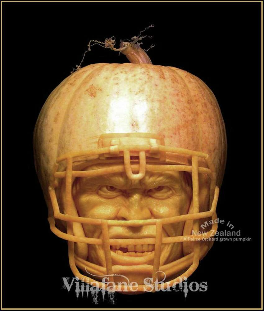Sometimes the shape of the pumpkin itself dictates the carving, as with this football-inspired pumpkin.