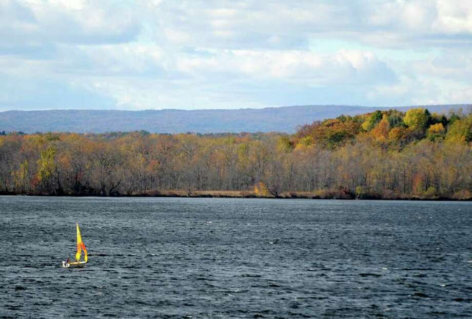 A lone sailboat takes advantage of the winds and the sun to skim across Saratoga Lake, N.Y. October 25, 2011.    (Skip Dickstein / Times Union) Photo: SKIP DICKSTEIN / NWest PRS 2011
