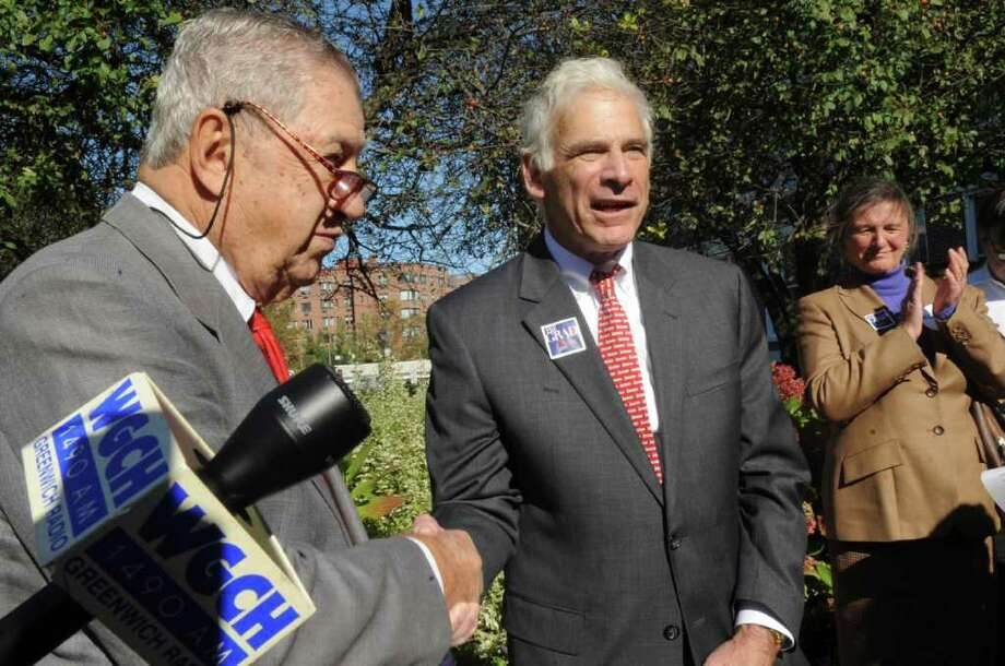Lou Caravella, a Democrat and town tax collector from 1998 to 2009, endorses Bill Grad for the post in an announcement on the steps of Town Hall Tuesday, Oct. 25, 2011. Photo: Helen Neafsey / Greenwich Time