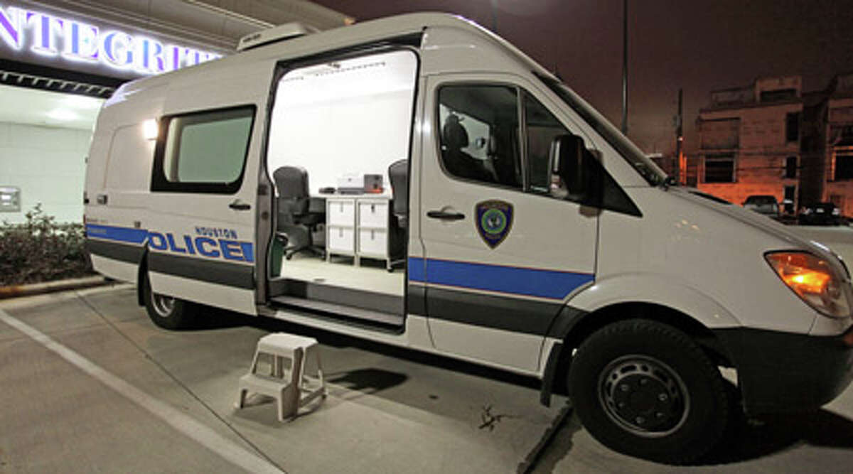 The Houston Police Department's BAT van sits in the parking lot of Integrity Bank off Washington Avenue. The mobile booking and processing unit is used to test those arrested for alcohol-related offenses. (HOLLY DUTTON/FOR THE CHRONICLE)