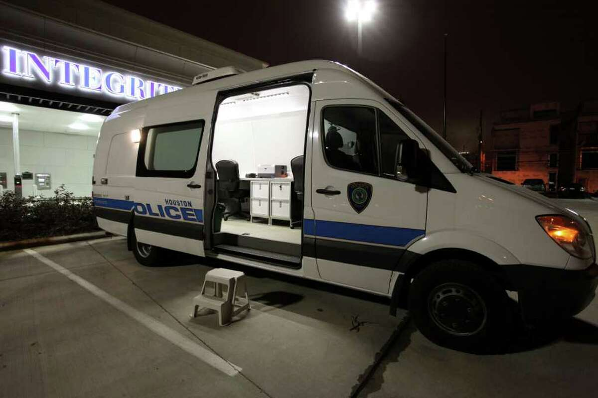 """The Houston Police Department's """"BAT"""" van sits in the parking lot of Integrity Bank off Washington Avenue. The mobile booking and processing unit is used to test those arrested for alcohol-related offenses."""