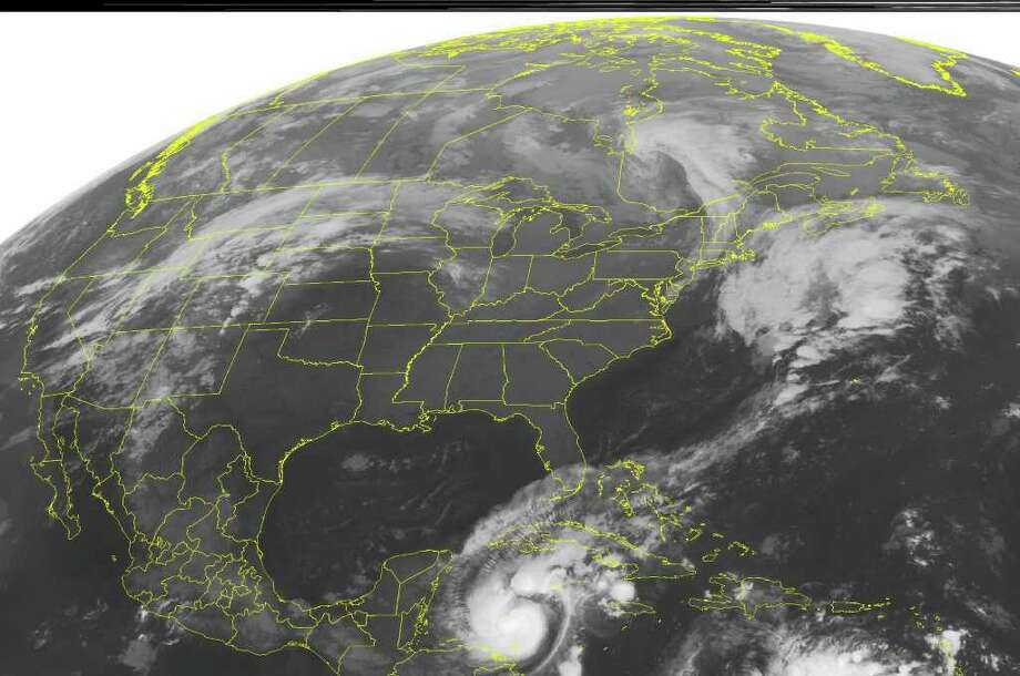 This NOAA satellite image taken Tuesday, Oct. 25, 2011 at 12:00 AM EDT shows few clouds in the east as high pressure builds in the region.  In the Caribbean, Hurricane Rina threatens the Yucatan Peninsula. (AP PHOTO/WEATHER UNDERGROUND) / WEATHER UNDERGROUND