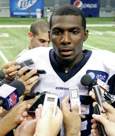 FOR SPORTS -  Wide receiver Dez Bryant answers questions from the media following the afternoon session of Dallas Cowboys training camp Monday Aug. 1, 2011 at the Alamodome.  (PHOTO BY EDWARD A. ORNELAS/eaornelas@express-news.net) Photo: EDWARD A. ORNELAS, SAN ANTONIO EXPRESS-NEWS / © SAN ANTONIO EXPRESS-NEWS (NFS)