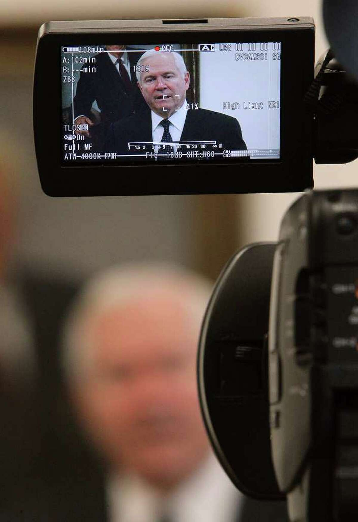 Former Defense Secretary Robert Gates speaks to media before his appearance at Trinity University's lecture series on Tuesday, Oct. 25, 2011. Gates touched on topics such as the impending troop withdrawal from Iraq, the ongoing strife in Libya and the implications of friendly fire in the recent death of Marine Lance Cpl. Benjamin Whetstone Schmidt. Kin Man Hui/kmhui@express-news.net