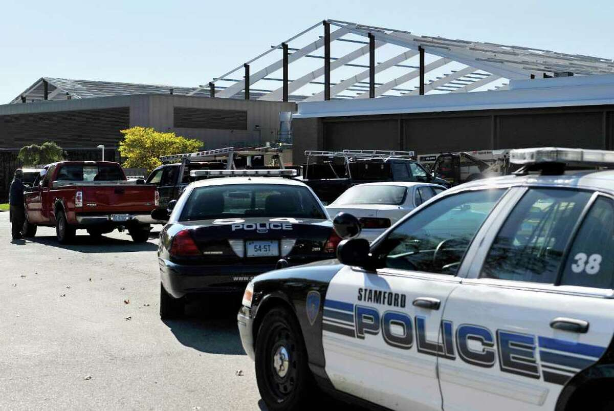 Stamford Police respond to a construction accident involving a worker who fell off a roof at Chelsea Piers in Stamford, Conn., Tuesday, Oct. 25, 2011. Stamford police Capt. Richard Conklin said a man in his 30s from Danbury, died after falling while working on a roof at the under-construction Chelsea Piers sports complex. (AP Photo/Jessica Hill)