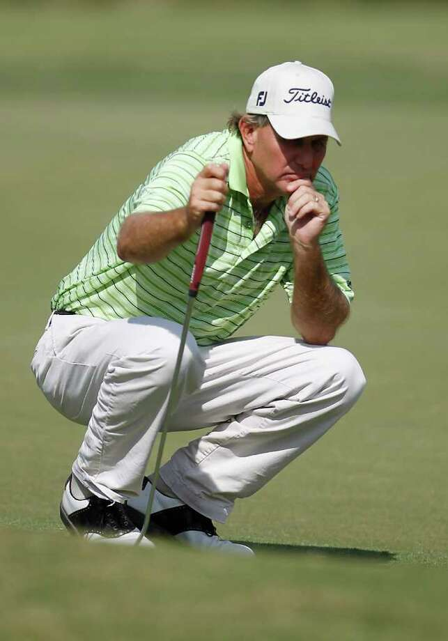 Ron Schroeder lines up his putt on the 18th green during the first of four days of Champions Tour Q School at the Woodforest Golf Club, Oct. 25, 2011, in Montgomery. Photo: Karen Warren, Houston Chronicle / © 2011 Houston Chronicle