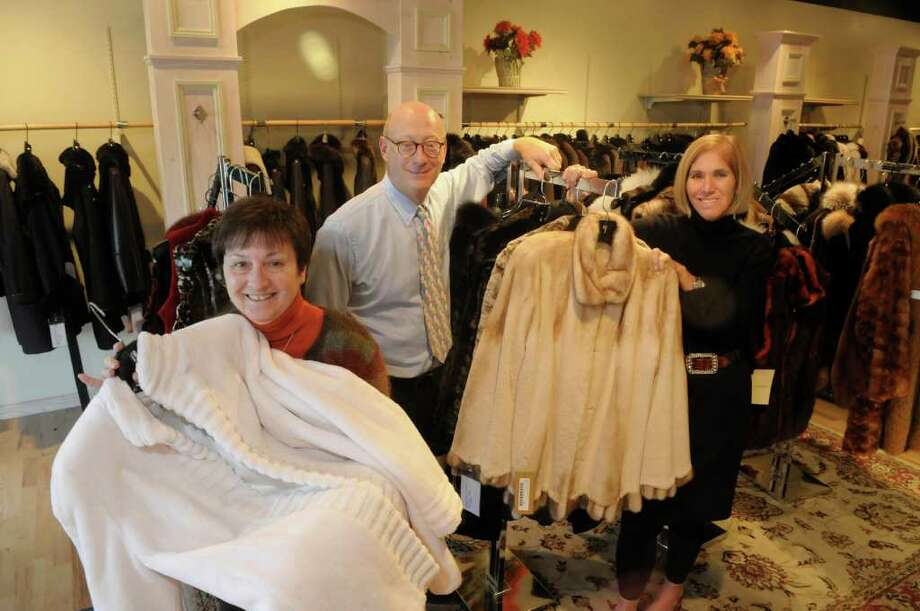 Debbie Kennedy, left, assistant manager, Michael Zeller, owner, and Donna Dague, mamnager, pose inside the store at Max Zeller Furs on Tuesday, Oct. 25, 2011 in Latham.  With the recent  loss of a long-time manager and because of the economy  the fur shop will be closing early next year.   (Paul Buckowski / Times Union) Photo: Paul Buckowski