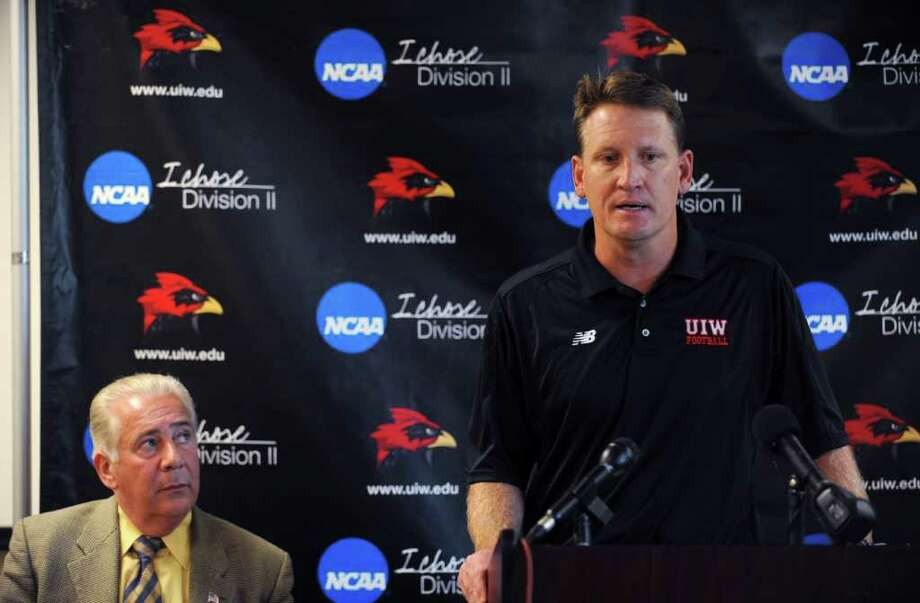 UIW interim coach Todd Ivicic (right) and school president Louis Agnese discuss the departure of Mike Santiago. Photo: Billy Calzada / gcalzada@express-news.net