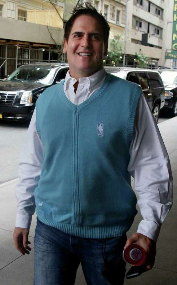 """Mark Cuban, owner of the Dallas Mavericks basketball team, arrives for labor talks Tuesday, Oct. 4, 2011 in New York. Owners and players arrived for a """"very huge day"""" in the NBA, with perhaps the fate of the league's 82-game schedule at stake. (AP Photo/Bebeto Matthews) Photo: Bebeto Matthews"""