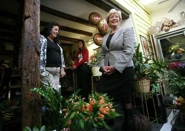 U.S. Senate candidate Linda McMahon, right, visits with business owner Alice Dinihanian Arcuri, left, at Booth House of Flowers in Stratford on Tuesday, October 25, 2011. Photo: Brian A. Pounds / Connecticut Post